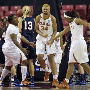 Photo - Texas players, from left to right, Nekia Jones, Imani McGee-Stafford and Empress Davenport celebrate a basket against Penn during the second half of the first round of the NCAA women's college basketball tournament on Sunday, March 23, 2014, in College Park, Md. Texas won 79-61. (AP Photo/Gail Burton)