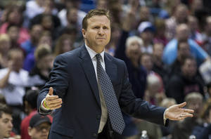 Photo - Oklahoma City Thunder's head coach Scott Brooks reacts to a call against the Milwaukee Bucks during the first half of an NBA basketball game on Saturday, March 30, 2013, in Milwaukee. (AP Photo/Tom Lynn)  ORG XMIT: WITL111
