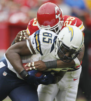 Photo -   San Diego Chargers tight end Antonio Gates (85) is tackled by Kansas City Chiefs strong safety Eric Berry (29) during the first half of an NFL football game at Arrowhead Stadium in Kansas City, Mo., Sunday, Sept. 30, 2012. (AP Photo/Colin E. Braley)