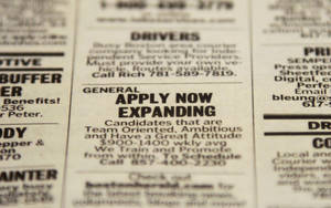 Photo - In this Tuesday, Dec. 11, 2012 photo taken in Walpole, Mass., an advertisement in the classified section of the Boston Herald newspaper calls attention to possible employment opportunities.  A survey of U.S. chief executives shows the number of large companies that plan to add jobs or hire more workers is essentially unchanged versus three months ago, although fewer expect hiring to decrease. The Business Roundtable said Wednesday. Dec 12, that 29 percent of its member CEOs plan to increase hiring over the next six months, but only 29 percent expect hiring to decrease versus 34 percent in the previous report. (AP Photo/Steven Senne)