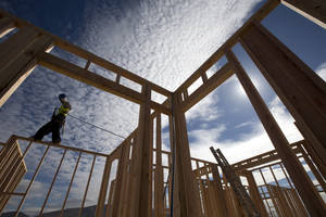 photo - In this Friday, Nov. 16, 2012, photo, construction worker Elabert Salazar works on a house frame for a new home in Chula Vista, Calif.  U.S. builders broke ground on fewer homes in November after starting work in October at the fastest pace in four years. Superstorm Sandy likely slowed starts in the Northeast. The Commerce Department said Wednesday, Dec. 19, 2012, that builders began construction of houses and apartments at a seasonally adjusted annual rate of 861,000. That was 3 percent less than October&#039;s annual rate of 888,000, the fastest since July 2008. (AP Photo/Gregory Bull)