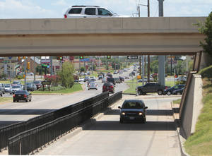 Photo - A plan to create a Texas turnaround with a pedestrian sidewalk at NW 10 and Interstate 235, similar to this one along Pennsylvania Avenue under the Kilpatrick Turnpike, is drawing concern from Oklahoma City Urban Renewal Commissioners. Photo by David McDaniel, The Oklahoman