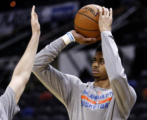 Photo - Oklahoma City's Jeremy Lamb (11) warms up before Game 5 of the Western Conference Finals in the NBA playoffs between the Oklahoma City Thunder and the San Antonio Spurs at the AT&T Center in San Antonio, Thursday, May 29, 2014. Photo by Sarah Phipps