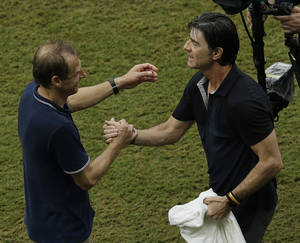 Photo - United States' head coach Juergen Klinsmann, left and Germany's head coach Joachim Loew greet each other after the group G World Cup soccer match between the USA and Germany at the Arena Pernambuco in Recife, Brazil, Thursday, June 26, 2014. Germany beat the United States 1-0. (AP Photo/Hassan Ammar)