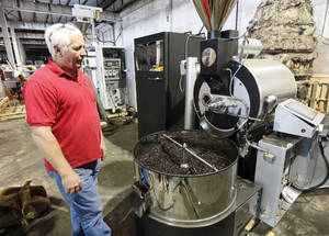 Photo - US Roaster Corp. Owner Dan Joliff demonstrates one of the roasters that his company creates in Oklahoma City, OK, Tuesday, September 24, 2013,  Photo by Paul Hellstern, The Oklahoman