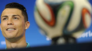 Photo - Portugal's Cristiano Ronaldo attends a news conference the day before the group G World Cup soccer match between Germany and Portugal at the Arena Fonte Nova in Salvador, Brazil, Sunday, June 15, 2014.  (AP Photo/Paulo Duarte)