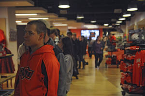 Photo - Oklahoma State University student Austin Moore waits in line to pay for his books Monday in Stillwater.  Photo by Jonathan Sutton, for The Oklahoman