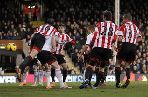 Photo - Fulham's Steve Sidwell, third right partially hidden, scores against Sunderland during their English Premier League soccer match at Craven Cottage, London, Saturday, Jan. 11, 2014. (AP Photo/Sang Tan)
