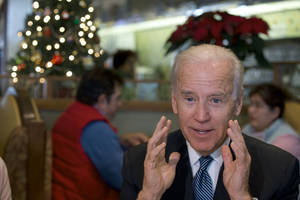 Photo - Vice President Joe Biden speaks to the media after eating lunch with middle class tax-payers, Friday, Dec. 7, 2012, at the Metro 29 diner in Arlington, Va. (AP Photo/Jacquelyn Martin)