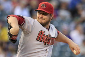 photo -   Arizona Diamondbacks starting pitcher Wade Miley winds-up to pitch Colorado Rockies' Dexter Fowler during the first inning of a baseball game Friday, Sept. 21, 2012 in Denver. (AP Photo/Barry Gutierrez)
