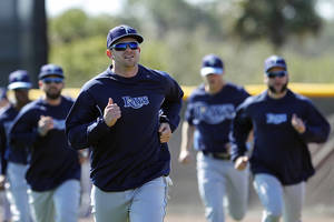 photo - Tampa Bay Rays third baseman Evan Longoria (3) leads running drills during baseball spring training, Sunday, Feb. 17, 2013, in Port Charlotte, Fla. (AP Photo/Charlotte Sun, Tom O'Neill)  SARASOTA OUT