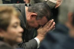 photo - Luis Artiga reacts after being acquitted on all charges in the Bell corruption trial on Wednesday, March 20, 2013, in Los Angeles.  Five former elected officials were convicted of multiple counts of misappropriation of public funds.  Former Mayor Oscar Hernandez and co-defendants George Cole, Teresa Jacobo, George Mirabal,  and Victor Belo were all convicted of multiple counts and acquitted of others.  The charges against them involved paying themselves inflated salaries of up to $100,000 a year in the city of 36,000 people, where one in four residents live below the poverty line.   (AP Photo/Los Angeles Times, Irfan Khan, Pool)
