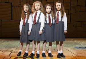 "Photo - This theater publicity image released by Boneau/Bryan-Brown shows the four actresses who share the title role in ""Matilda The Musical,"" from left, Bailey Ryon, Milly Shapiro, Sophia Gennusa, and Oona Laurence on stage at the Shubert Theatre in New York. (AP Photo/Boneau/Bryan-Brown, Joan Marcus)"