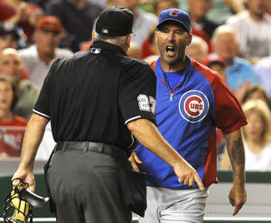 Photo -   Chicago Cubs manager Dale Sveum, right, confronts home plate umpire Larry Vanover after being thrown out of a baseball game in the fifth inning against the Washington Nationals at Nationals Park, Wednesday, Sept. 5, 2012, in Washington. (AP Photo/Richard Lipski)
