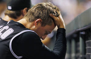 Photo -   Colorado Rockies infielder Jordan Pacheco reacts after the Oakland Athletics scored three runs in the ninth inning of the Athletics' 10-8 victory in a interleague baseball game in Denver on Wednesday, June 13, 2012. The loss was the seventh in a row for the Rockies. (AP Photo/David Zalubowski)