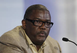 Photo - In this July 16, 2013, photo, Detroit Pistons President of Basketball Operations Joe Dumars speaks during a news conference in Auburn Hills, Mich. The Pistons have decided not to renew Dumars' contract as president of basketball operations, a person familiar with the situation said Sunday, April 13, 2014. The person, who spoke on condition of anonymity because the team has not made any announcement on Dumars' future, says Dumars will remain with the Pistons as an adviser. (AP Photo/Carlos Osorio)