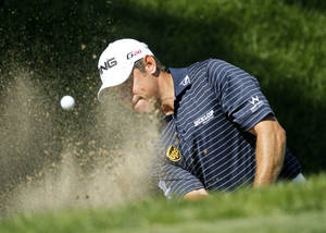 Photo -   Lee Westwood, of England, hits out of the bunker on the ninth green during the final round of the BMW Championship PGA golf tournament at Crooked Stick Golf Club in Carmel, Ind., Sunday, Sept. 9, 2012. (AP Photo/Charles Rex Arbogast)