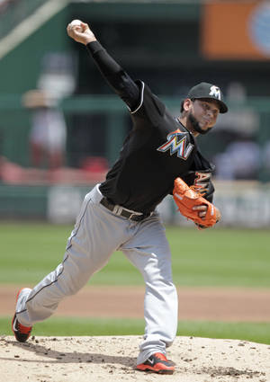 Photo - Miami Marlins starting pitcher Henderson Alvarez delivers a pitch in the first inning of a baseball game against the St. Louis Cardinals, Sunday, July 6, 2014 in St. Louis. (AP Photo/Tom Gannam)