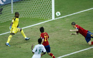 Photo - Spain's Fernando Torres, right, scores his side's 2nd goal during the soccer Confederations Cup group B match between Nigeria and Spain at the Castelao stadium in Fortaleza, Brazil, Sunday, June 23, 2013. (AP Photo/Victor R. Caivano)