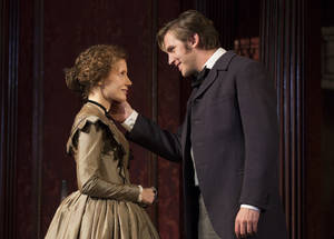 "Photo - This theater image released by Boneau/Bryan-Brown shows Jessica Chastain, left, and Dan Stevens in a scene from ""The Heiress,"" during a performance at the Walter Kerr Theatre in New York. The show's producers said Monday, Feb. 4, 2013, the production will recoup its $3 million capitalization by the time the show closes on Saturday. By then, ""The Heiress"" will have played 27 previews and 117 regular performances. (AP Photo/Boneau/Bryan-Brown, Joan Marcus)"