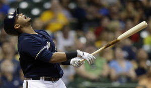 Photo - Milwaukee Brewers' Martin Maldonado reacts as he pops out with bases loaded during the fourth inning of a baseball game against the Los Angeles Angels, Friday, Aug. 30, 2013, in Milwaukee. (AP Photo/Morry Gash)