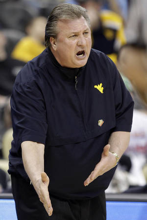 photo - West Virginia coach Bob Huggins has already spent some time in the Big 12, coaching at Kansas State. AP photo