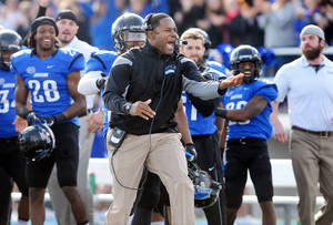 "Photo - This Nov. 16, 2013 photo shows Eastern Illinois University's head football coach Dino Babers, center, reacting as EIU plays Jacksonville State in an NCAA college football game at O'Brien Field in Charleston, Ill. In Dino Babers' world there is no pretty good. There is only good, and everything else. ""Don't even use the PG word,"" the high-energy head coach at Eastern Illinois says. His (12-1), Panthers getting ready to play Friday, Dec. 13, 2013 in the Football Championship Subdivision quarterfinals against Towson.  And they have a quarterback in Jimmy Garoppolo who has rewritten the Panther and Ohio Valley Conference record books and is probably headed to the NFL. (AP Photo/Journal Gazette/ Times-Courier, Kevin Kilhoffer)"