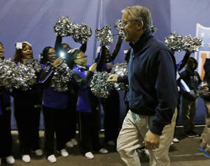 Photo - Seattle Seahawks head coach Pete Carroll smiles as he arrives for media day for the NFL Super Bowl XLVIII football game Tuesday, Jan. 28, 2014, in Newark, N.J. (AP Photo/Jeff Roberson)