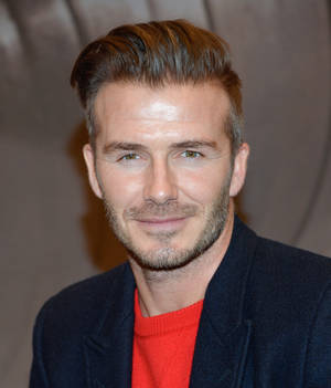 Photo - FILE - In a Saturday, Feb. 1, 2014 file photo, former England soccer player and model David Beckham makes an appearance at H&M Times Square for his new men's underwear line, in New York. Beckham will take part in a news conference Wednesday, Feb. 5, 2014 to discuss his progress in trying to bring a Major League Soccer expansion team to Miami. MLS Commissioner Don Garber and Miami-Dade County Mayor Carlos Gimenez also will attend the session, which was announced Monday, Feb. 3. The league has discussed placing its next two expansion teams in Miami and Atlanta. (Photo by Evan Agostini/Invision/AP, File)