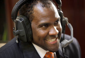 photo - Oklahoma State University's Jason Jones laughs during a radio interview for the Big 12 Conference Football Media Days in Irving, Texas, Monday, July 27, 2009. Photo by Bryan Terry, The Oklahoman