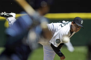 Photo - Seattle Mariners starting pitcher Felix Hernandez throws against the Tampa Bay Rays in the fourth inning of a baseball game, Wednesday, Aug. 15, 2012, in Seattle. Hernandez pitched the Seattle Mariners' first perfect game and the 23rd in baseball history. (AP Photo/Ted S. Warren)