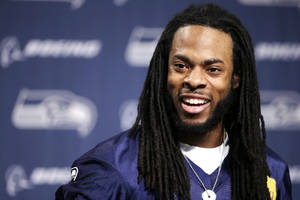 Photo - Seattle Seahawks' Richard Sherman speaks at an NFL football news conference Wednesday, Jan. 22, 2014, in Renton, Wash. The Seahawks play the Denver Broncos in the Super Bowl on Feb. 2. (AP Photo/Elaine Thompson)