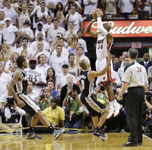 Photo - FILE - In this June 19, 2013 file photo, Miami Heat shooting guard Ray Allen (34) shoots a three-point basket in the final seconds of regulation during the second half of Game 6 of the NBA Finals basketball game against the San Antonio Spurs, in Miami. Allen's shot sent the game into overtime. For Ray Allen, it was The Summer of The Shot. Everywhere he went, all anyone wanted to talk to him about was the 3-pointer with 5.2 seconds left in Game 6 of the NBA Finals, the one that saved the Miami Heat title chances. And Allen didn't mind one bit, but even he says it's time to get ready for a new year. (AP Photo/Lynne Sladky, File)