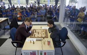 Photo -   Chess player Magnus Carlsen of Norway, left, and Fabiano Caruana of Italy compete during the Chess Grand Slam Final Masters inside a case of glass at the Ibirapuera Park in Sao Paulo, Brazil, Monday, Sept. 24, 2012. (AP Photo/Andre Penner)