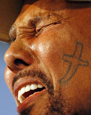 Photo -   Aaron Neville performs with his Gospel Experience at the New Orleans Jazz & Heritage Festival Saturday, May 5, 2012 in New Orleans. (AP Photo/The Times-Picayune, Brett Duke) MAGS OUT; NO SALES; USA TODAY OUT