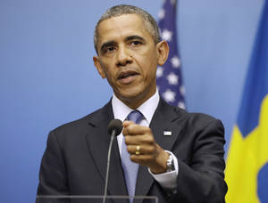 Photo - President Barack Obama gestures during his joint news conference with Swedish Prime Minister Fredrik Reinfeldt, Wednesday, Sept. 4, 2013, at the Rosenbad Building in Stockholm, Sweden. The president said international community and Congress credibility on the line on response to Syria . (AP Photo/Pablo Martinez Monsivais)
