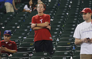 Photo - Texas Rangers fans remain in the stands after their team lost 5-2 to the Tampa Bay Rays at an American League wild-card tiebreaker baseball game Monday, Sept. 30, 2013, in Arlington, Texas. The Rays advance to face the Cleveland Indians in the American League wild-card playoff. (AP Photo/Tim Sharp)