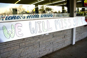 photo - A sign hangs Jan. 20, 2012, at the original Nichols Hills Drugstore and lunch counter.  The Oklahoma Archives Photo