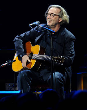 Guitarist Eric Clapton performs in concert at Madison Square Garden on Thursday, Feb. 18, 2010 in New York. (AP Photo/Evan Agostini)  ORG XMIT: NYEA108