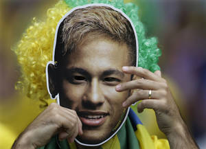 Photo - A Brazil supporter wears a Neymar mask before the World Cup semifinal soccer match between Brazil and Germany at the Mineirao Stadium in Belo Horizonte, Brazil, Tuesday, July 8, 2014. (AP Photo/Natacha Pisarenko)