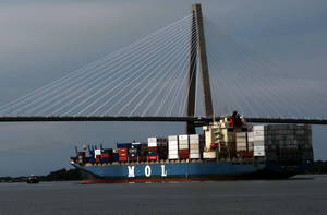 Photo - FILE - In this  May 21, 2013, file photo, a container ship moves toward the docks in Charleston, S.C.  The Commerce Department reports on the U.S. current account trade deficit for the April-June quarter on Thursday, Sept. 19, 2013. (AP Photo/Bruce Smith, File)