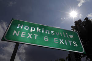 Photo -   This Aug. 27, 2012 photo shows a road sign under the afternoon sun outside Hopkinsville, Ky. When the next total eclipse of the sun darkens skies over parts of the United States on Aug. 21, 2017, the afternoon event will last longer in a rural stretch near Hopkinsville than any place on the planet. (AP Photo/Mark Humphrey)