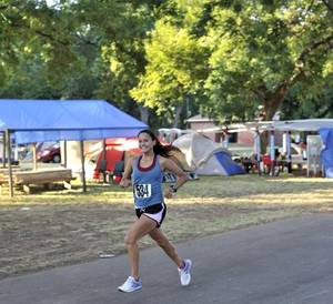 Photo - Kelly Waters, 2011 overall ladies champion, runs through the campgrounds at last year's Otoe Run in Red Rock, OK. The run is hosted by the Otoe-Missouria Tribe. (Photo provided)