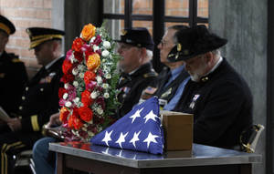 photo -   An urn holding the remains of Civil War veteran Peter Knapp sit with an American flag during his military funeral at Willamette National Cemetery in Portland, Ore., Friday, April 13, 2012. Peter Knapp is the first Civil War veteran buried at Willamette National Cemetery, Oregon's largest veterans' cemetery. His ashes had been sitting on a shelf at the Portland Crematorium since 1924.(AP Photo/Don Ryan)