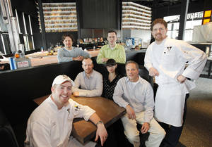 Photo - Republic Gastropub at Classen Curve opened Monday. Shown are, seated left to right, Luke Fry,  Jason Ewald, Ariana Khalilian and Kurt Shewmaker and, standing, Keith Paul, Jordan Winteroth and Robert Black. Photo by David McDaniel, The Oklahoman