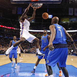 Photo - NBA BASKETBALL: Oklahoma City's' Kendrick Perkins (5) dunks the ball in front of Dallas' Brendan Haywood (33)  and Lamar Odom (7) during a preseason NBA game between the Oklahoma City Thunder and the Dallas Mavericks at Chesapeake Energy Arena in Oklahoma City, Tuesday, Dec. 20, 2011. Photo by Bryan Terry, The Oklahoman
