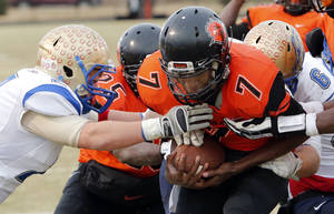 Photo - Trojan quarterback Patrick McKaufman scores the go ahead touchdown as Douglass defeats Oologah in high school football playoff action on Saturday, Nov. 23, 2013, in Oklahoma City, Okla. Photo by Steve Sisney, The Oklahoman