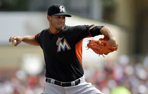 Photo - Miami Marlins starting pitcher Jose Fernandez throws during the first inning of an exhibition spring training baseball game against the St. Louis Cardinals Friday, Feb. 28, 2014, in Jupiter, Fla. (AP Photo/Jeff Roberson)