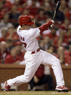 photo - St. Louis Cardinals' Pete Kozma hits an RBI double in his first major league at-bat, during the fifth inning of a baseball game against the Houston Astros on Wednesday, May 18, 2011, in St. Louis. (AP Photo/Jeff Roberson) ORG XMIT: MOJR107
