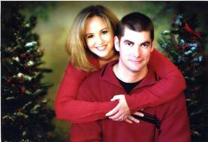 Photo - John Werhun, an Edmond firefighter, and his wife, Joyce, are seen in a 2009 Christmas photograph. PHOTO PROVIDED <strong>PROVIDED</strong>